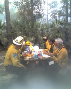 My first burn. They were burning in the campground.  I showed up with LUNCH, Hamburgers, fries and potato salad.   Site #3.  I got put to work right after this picture was taken. Took classes ASAP. Danny is the first one on the right, No hat on.